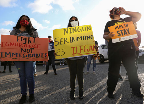 People in San Diego hold signs supporting the Deferred Action for Childhood Arrivals program June 18, 2020. (CNS photo/Mike Blake, Reuters)