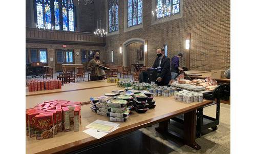 Volunteers help assembly Thanksgiving baskets in Marian Hall Fitzgerald Court on campus.
