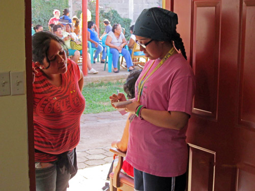Aidyanne takes down the name of a Nicaraguan woman who requested eyeglasses. The mission trip group expected a handful of people to come to the vision clinic, but 30 showed up.