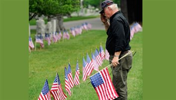 Help honor vets by placing flags on graves
