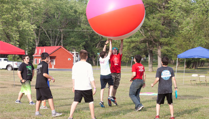 Participants play with a giant beach ball during their free time. (Nate Whitchurch photo)