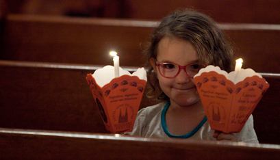 Emma Purcell holds a candle for her father and one for herself. (Nate Whitchurch photo)