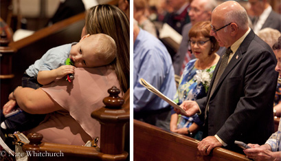 Two-year-old Lucas Lamadrid rests on his mother Michele's shoulder and Joe and Sharon Thouin, married 45 years, share a program. (Nate Whitchurch photos)