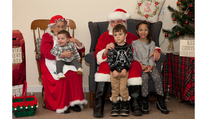 Santa and Mrs. Claus spend time with some new friends, from left, Gunner, Charlee and Kenzie Jones, at St. Michael's parish in Glens Falls for Breakfast with Santa, sponsored by the Altar Rosary Society Nov. 24.