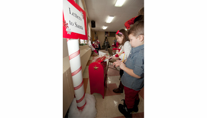 Jacob and Sophia Favreau mail their letters to Santa.