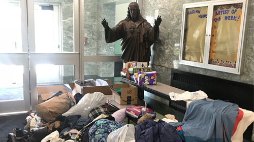 Bishop Maginn High School is a collection site for clothes, shoes, diapers and much more for families affected by last Friday's fire on Myrtle Avenue in Albany. (Emily Benson photo)