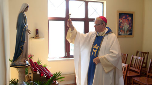 Bishop Scharfenberger blesses the newly dedicated chapel. (Nate Whitchurch photo)