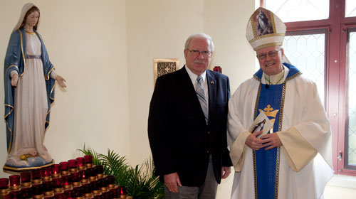 Bishop Edward Scharfenberger and Richard Siek pose for a photo in the chapel. (Nate Whitchurch photo)