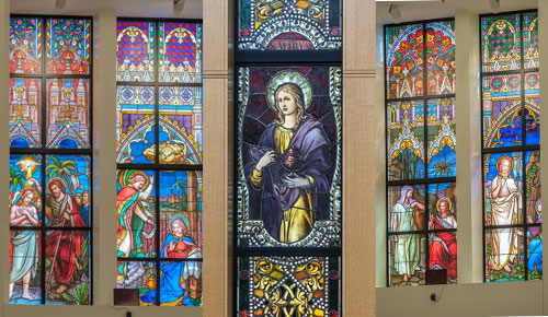 Five more stained glass windows from St. Paul the Apostle and St. Peter's churches, which both closed in 2009. The windows are now the focal point of St. Mary Magdalene Church in Apex, N.C. (Natasha Johnson photos)