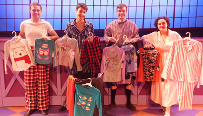 "Student actors, Connor Rock (from left to right), Dominic DiCaprio, William Curley and Fiona Hoye, all performers in Siena's fall production of ""The Pajama Game,"" show off some donated pajams for St. Catherine's Center for Children in Albany. ""The Pajama Game"" ran from Nov. 14-23, but the donation bin is still available for collection inside the Beaudoin Theater, located on Siena's campus. (Emily Benson photo)"